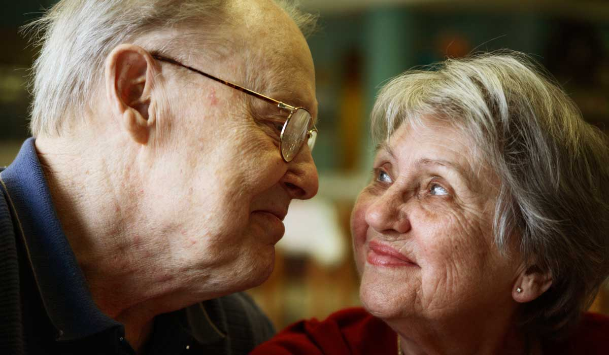 elderly couple looking and smiling each other