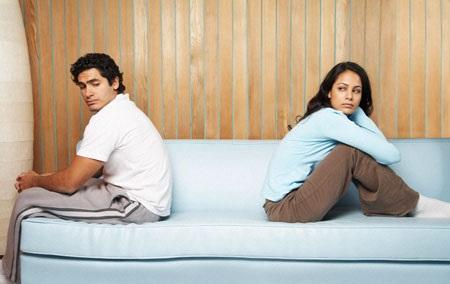 couple sitting on bed have relationship problem