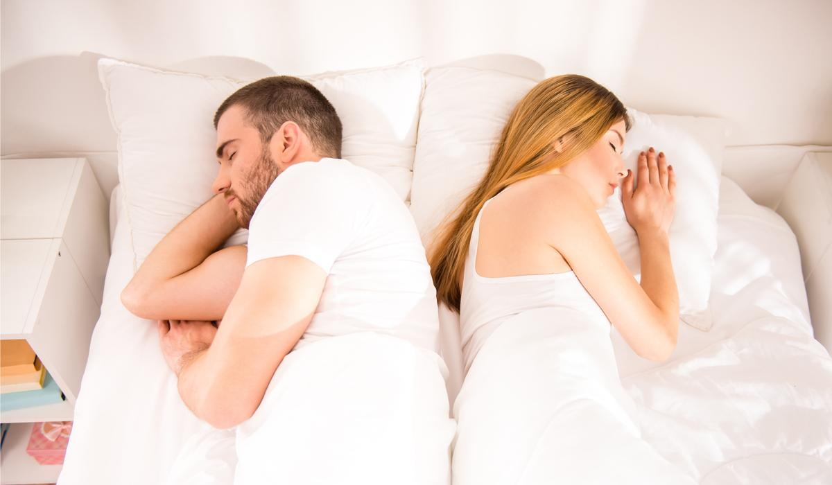 young couple with sex problem sleeping in bed