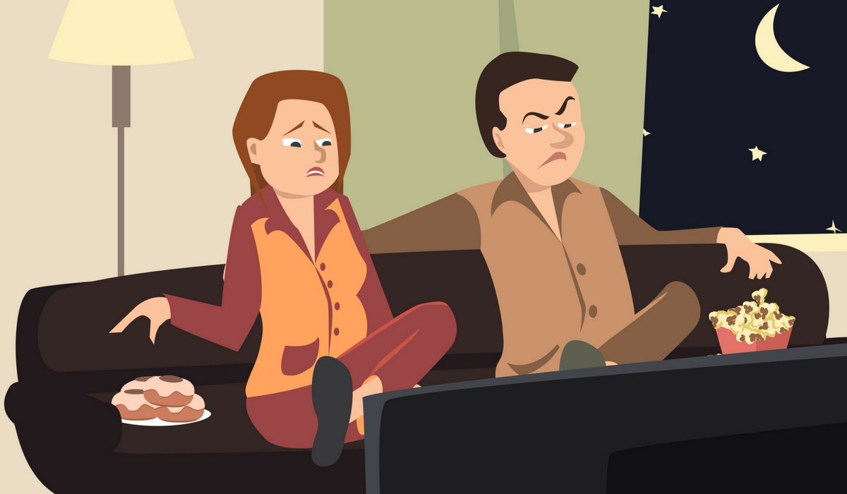 angry couple watching television